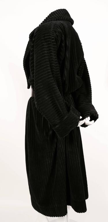 Very rare black elephant cord coat designed by Azzedine Alaia dating to fall of 1984. French size 40. Can fit numerous sizes due to the oversized cut. Fully lined. Pockets at hips. Made in France. Excellent condition. Belt available for purchase