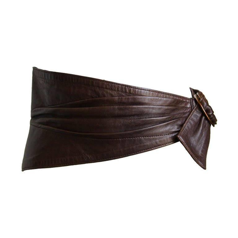 Chocolate brown butter soft ruched belt with antiqued brass size buckle from Azzedine Alaia dating to the 1980's. Belt size is unlabeled, but in comparison with a duplicate belt I had, I believe it is a French size 65, which fits a size 0-2