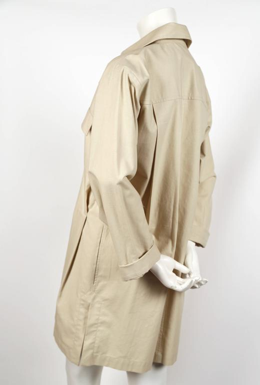 "Unworn tan cotton safari tunic dress from Yves Saint Laurent dating to the 1980's. French size 36. Measures approximately: 18"" drop shoulder, 40"" bust, 40 hips, 35"" length and 23"" arm length un-cuffed. Has an oversized fit. Silver hardware. Hidden"