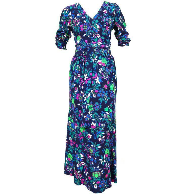 """Floral silk dress with long waist tie and v-neckline from Yves Saint Laurent dating to the late 1970's, early 1980's. Labeled a size French size 38 however this better suits a FR 36. Dress measures approximately: bust 34-37"""" (due to gathering),"""