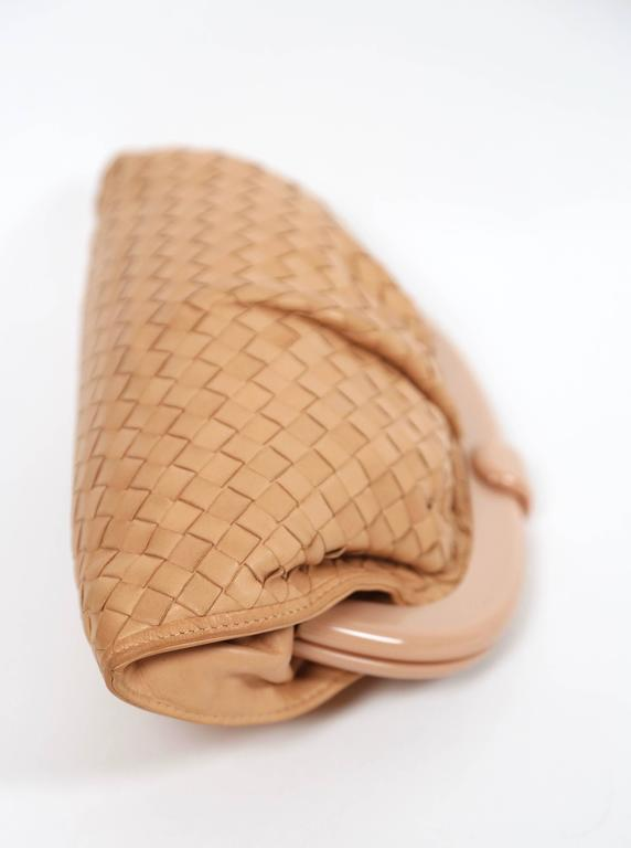 "Blush woven leather clutch with lucite frame designed by Bottega Veneta dating to the 1980's. Approximate measurements: 11.5"" long by 7"" tall by 3"" deep. Made in Italy. Dust bag included. Excellent condition."