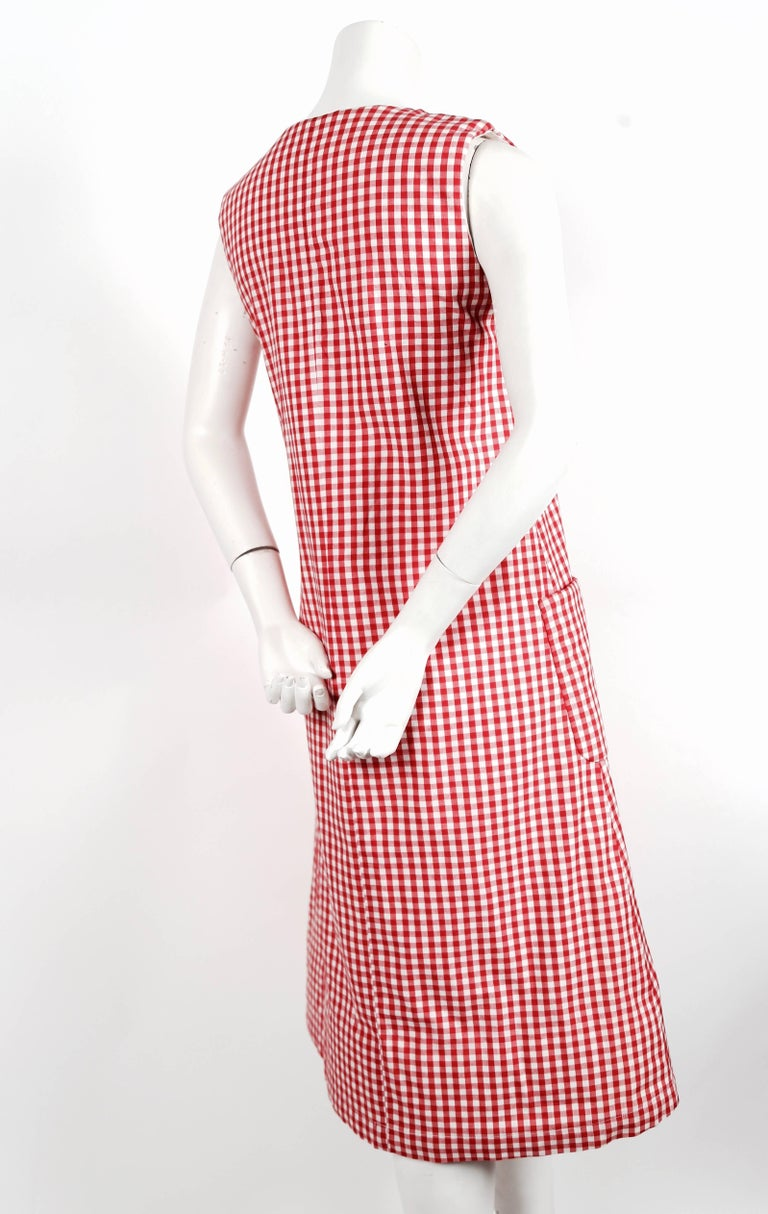 """Red gingham cotton dress with padding at shoulders and hem from Comme Des Garcons dating to the 1997 'Body meets dress, dress meets body' collection often referred to as the Lumps and Bumps collection. Size 'S'. Approximate measurements: bust 35"""","""