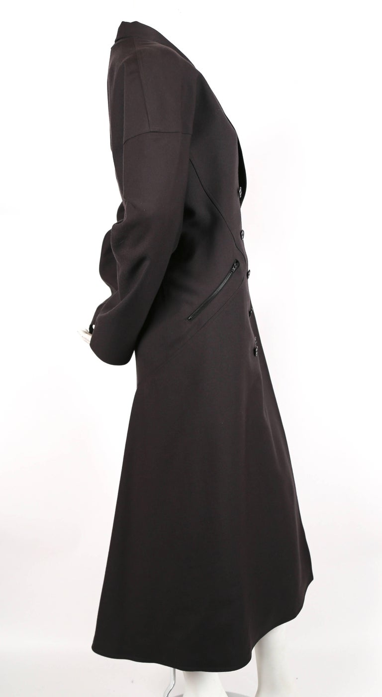 Stunning full length charcoal wool gabardine coat with intricately seamed panels from Azzedine Alaia dating to the 1980's. Seaming creates a fitted bodice with a flared hemline. Great movement when walking. Size is approximately a French size 40.