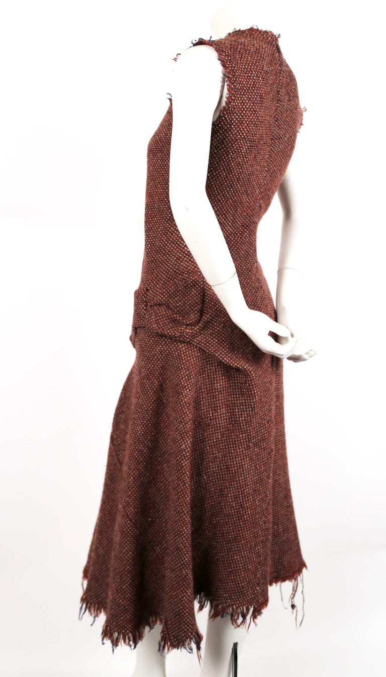 Fuzzy tweed wool dress with uniquely seamed 'bow' at left hip and frayed hemline designed by Junya Watanabe for Comme Des Garcons as seen on the fall 2003 runway. Size 'S'. Approximate measurements: shoulder 14