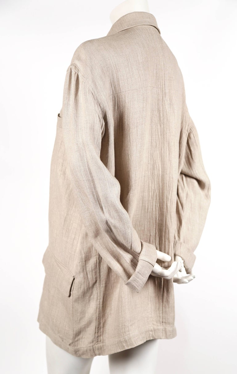 Oversized, flax colored, linen jacket with knotted fabric buttons designed by Issey Miyake for Plantation dating to the 1980's. Jacket is labeled a size 'M' however it has an oversized fit. Photographed unclipped on a US size 2 mannequin. Partially