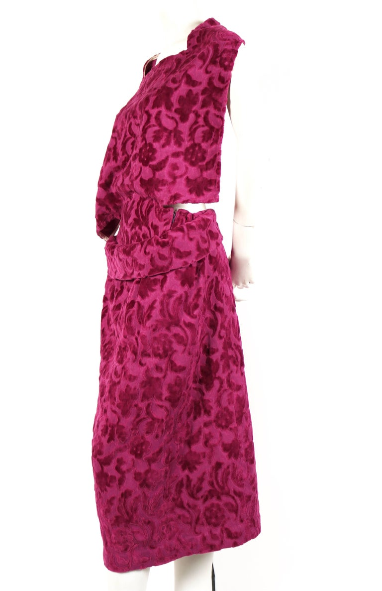 Very rare magenta purple flocked draped dress with open back designed by Rei Kawakubo for Comme Des Garcons dating to fall of 1996.  Labeled a size 'S'. Waist fits up to 26.5