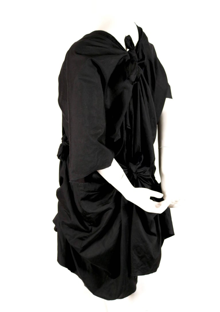 Jet black cotton knotted dress designed by Rei Kawakubo for Comme des Garcons dating to spring of 2003 as seen on the runway. Size M. Approximate length as currently knotted 34
