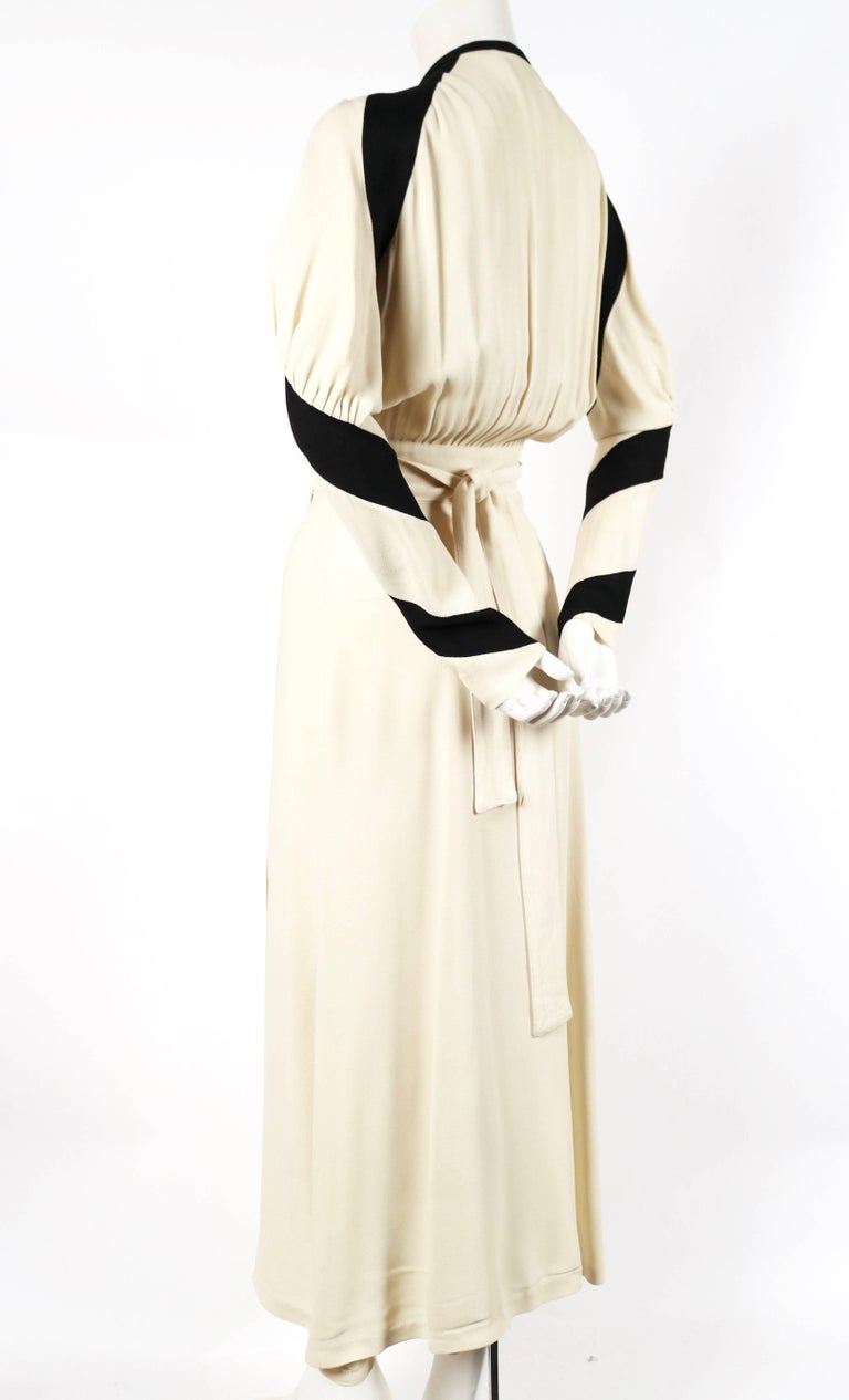 Very rare cream and black moss crepe dress designed by Ossie Clark for Quorum dating to 1970. Ossie Clark's wife at the time, textile designer Celia Birtwell, was painted in this dress in another colorway by David Hockney. This portrait was a