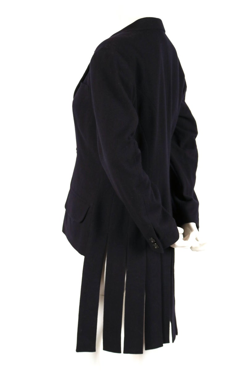 Very rare and unique black wool jacket with carwash hemline designed by Yohji Yamamoto dating to the 1980's. Jacket is labeled a size 'S'. Approximate measurements: shoulder 17