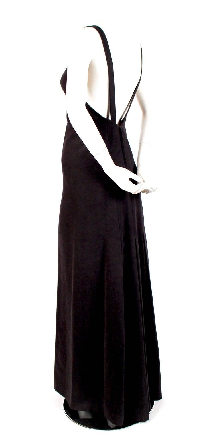 Very rare black ultrasuede gown with low back, plunging neckline and contoured bodice from Issey Miyake dating to the late 1970's. Dress is labeled a size 8, however it best fits a US 2-4. Approximate measurements: bust 32