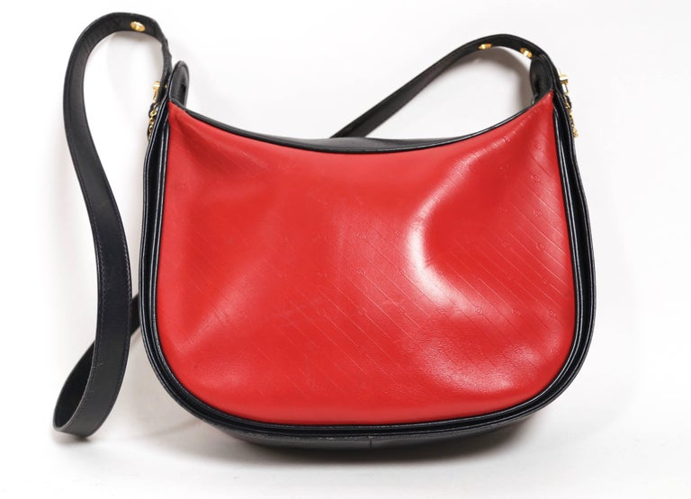 Women's or Men's 1980's GUCCI navy and red embossed monogrammed leather bag  For Sale