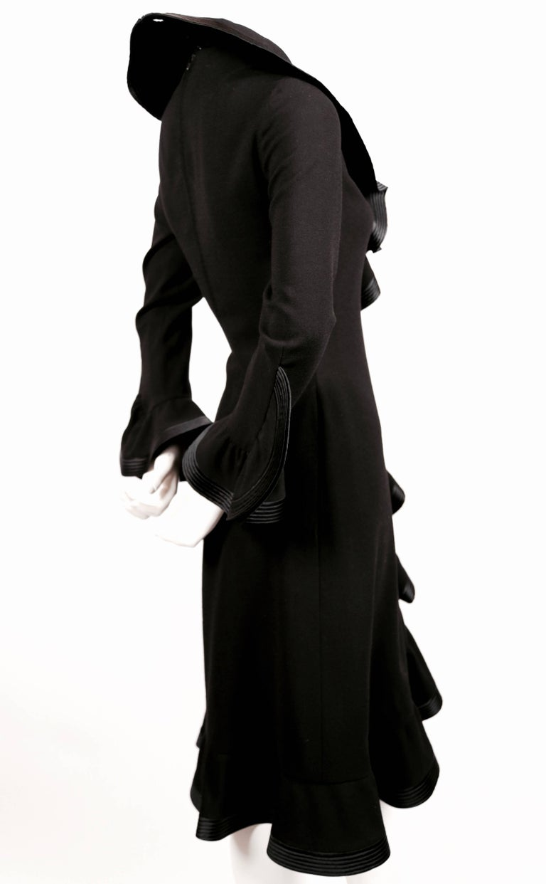 Jet black haute couture wool dress with beautiful flounce trimmed in satin from Pierre Balmain dating to the late 1960's. All of the details you would expect with a haute couture garment. Dress fits a US size 2-4. Approximate measurements: bust 32