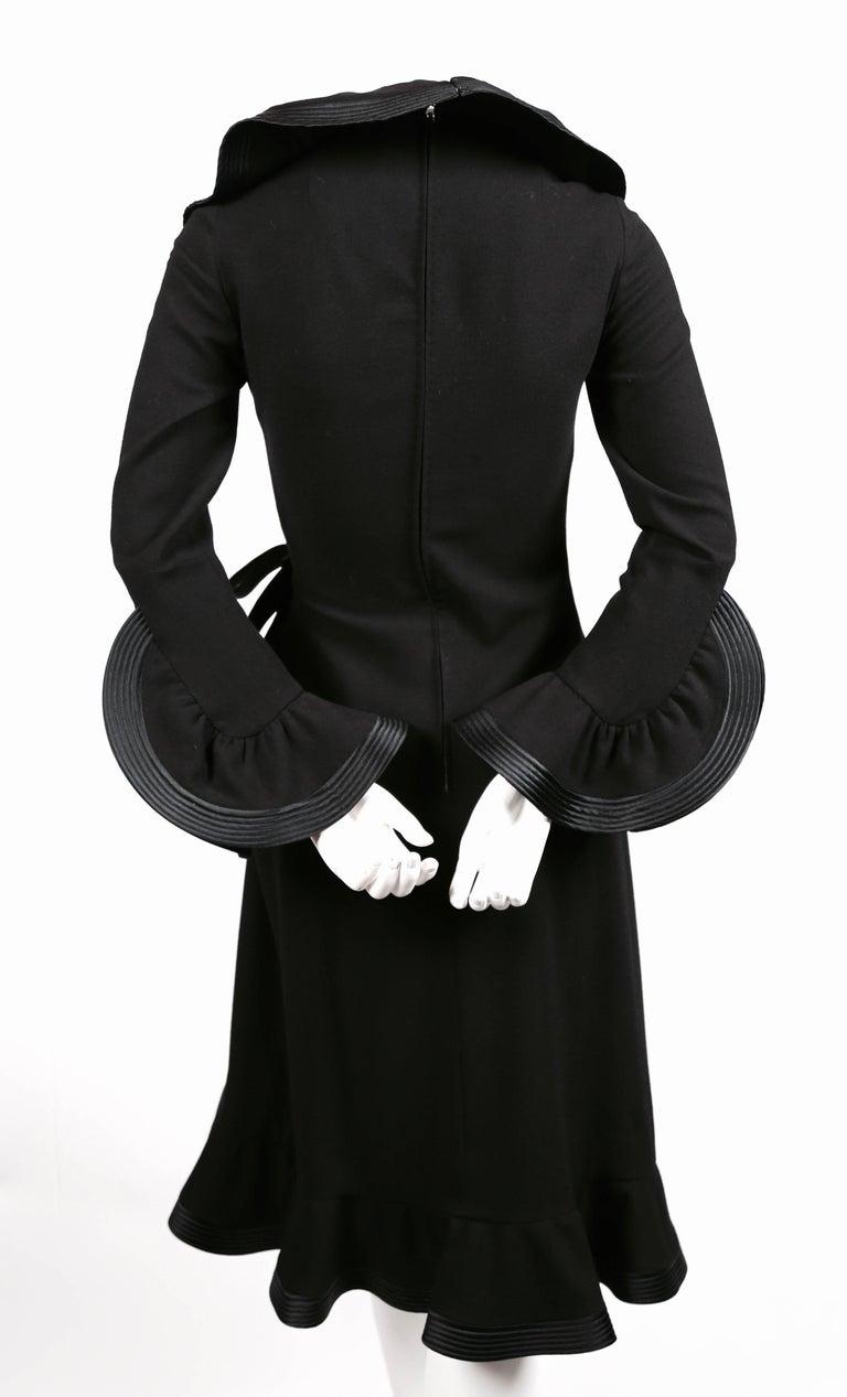 Women's 1960's PIERRE BALMAIN haute couture black dress with flounced trim For Sale