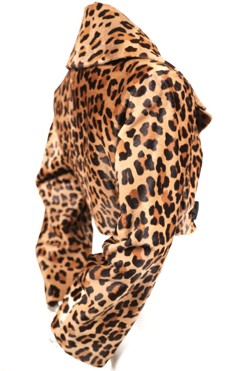 Extremely rare leopard printed calf fur jacket with decorative black frog closure designed by Azzedine Alaia dating to fall of 1991 exactly as seen on the runway. Labeled a French size 40 although there is some flexibility due to the cut.