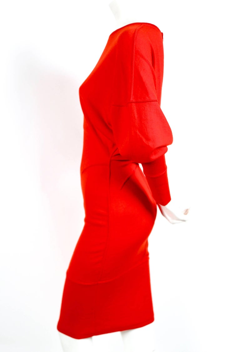Vivid red knit dress with dolman cut sleeves from Azzedine Alaia dating to the 1980's. Dress fits a size S or M. Snap closure at back of neck. Made in Italy. Excellent condition.