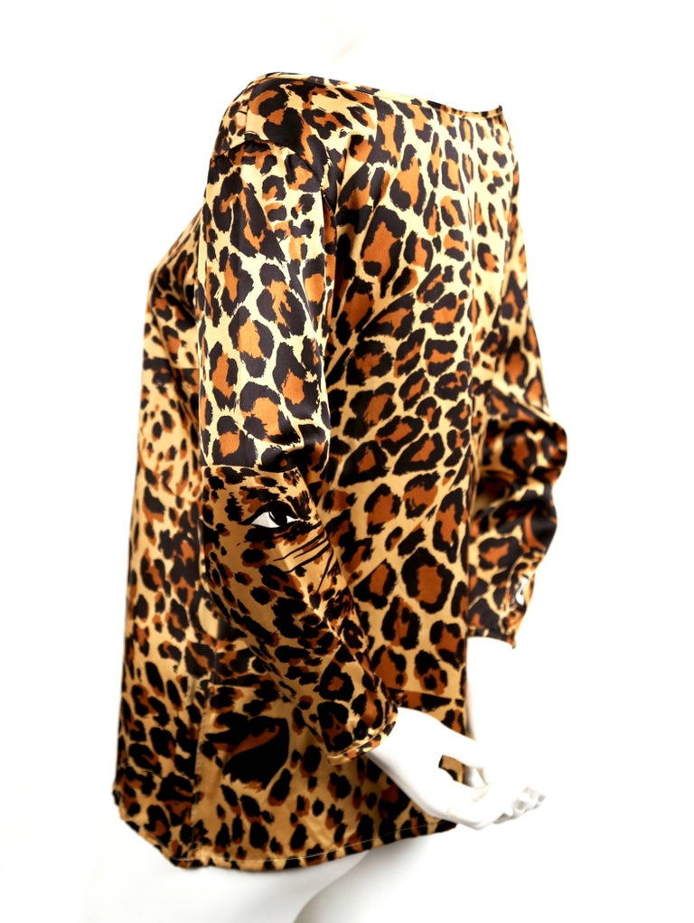 Leopard printed silk top with boat neckline from Yves Saint Laurent dating to Fall 1986. Labeled a French size 38. Approximate measurements: shoulders 18