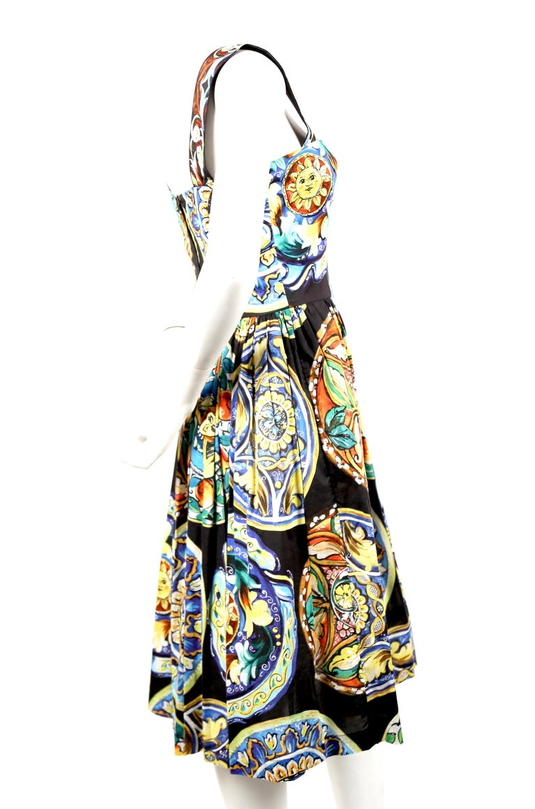 Floral printed cotton day dress designed by Dolce & Gabbana. Labeled an Italian size 42 however it best fits a US 2-4. Approximate measurements: 32