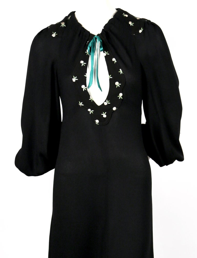 Jet black moss crepe long dress with long billowy sleeves, plunging keyhole neckline and floral embroidery designed by Ossie Clark for Radley dating to the 1970's. Dress is labeled a size '36', although it fits a US 2-4. Measurements are somewhat