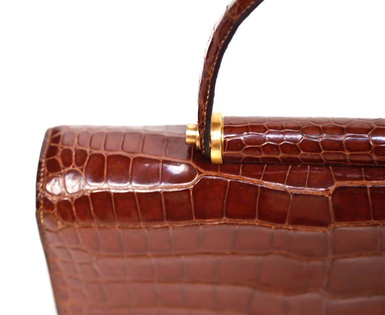 Hermes crocodile top handle bag with geometric hardware, 1940s  2