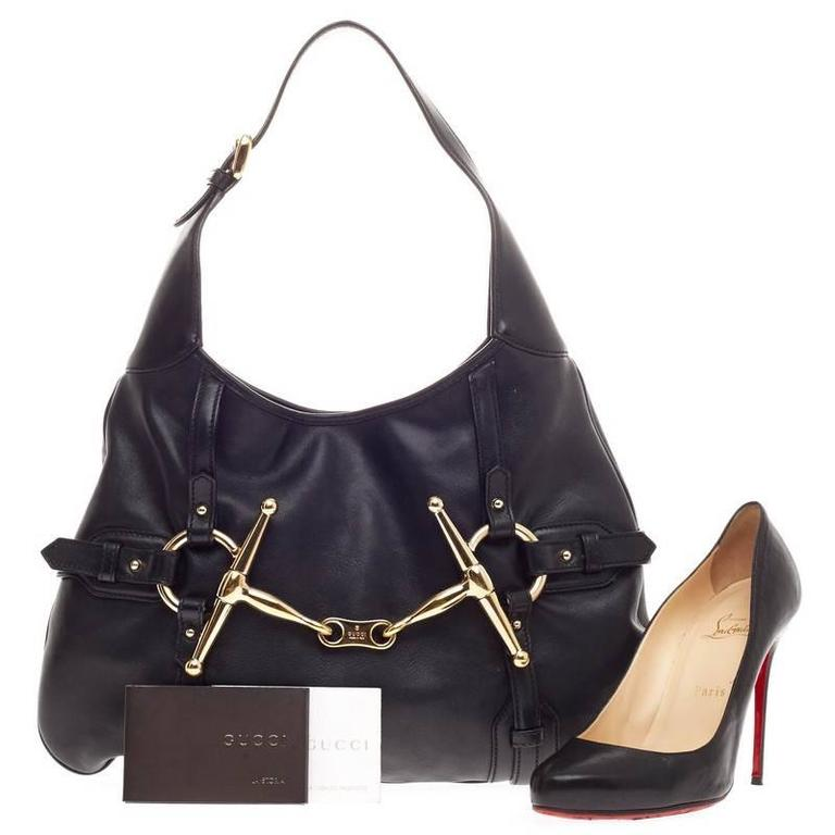 de3cab14fb6a This authentic Gucci Limited Edition 85th Anniversary Hobo Leather is an  elegant