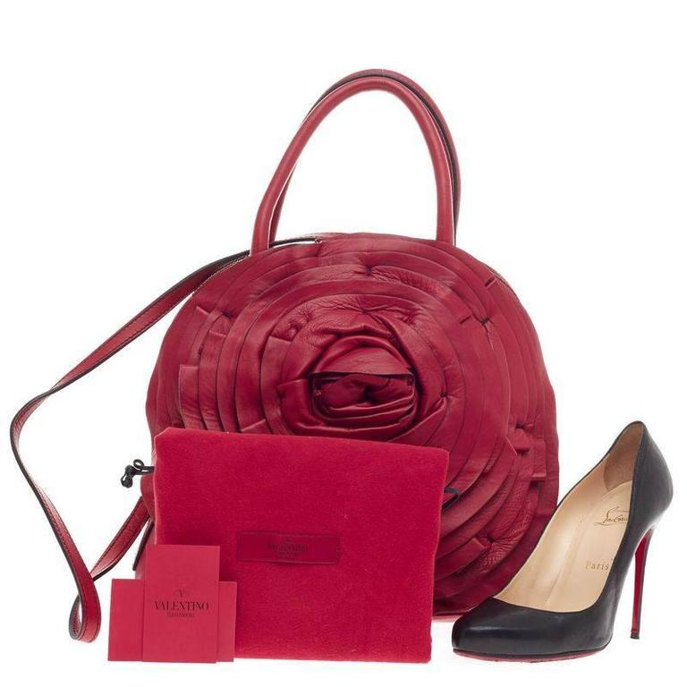 78ae108ea3a This authentic Valentino Petale Dome Bag Leather is a romantic and  feminine, eye-catching