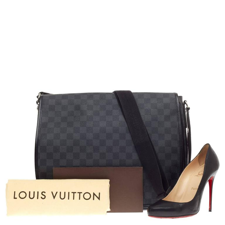 a37563173c1e This authentic Louis Vuitton Daniel Messenger Damier Graphite GM is the  ideal bag for any style