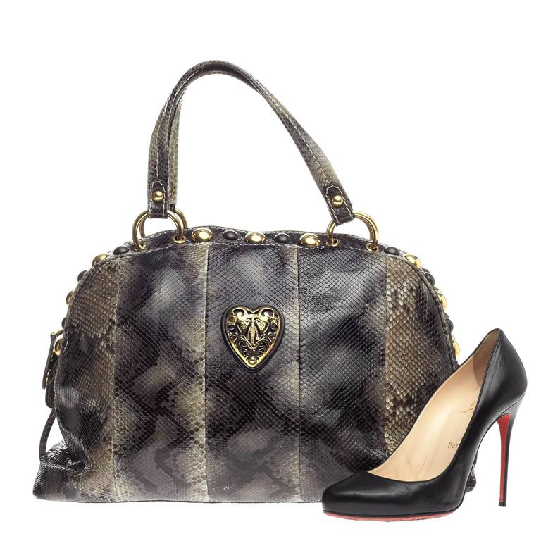 82c428870268 This authentic Gucci Babouska Heart Dome Satchel Python Medium is  sophisticated and luxurious in design ideal