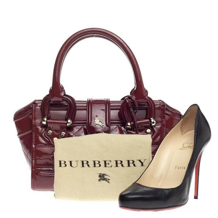 0432890012 This authentic Burberry Manor Bag Quilted Patent Mini is sophisticated in style  perfect for everyday casual