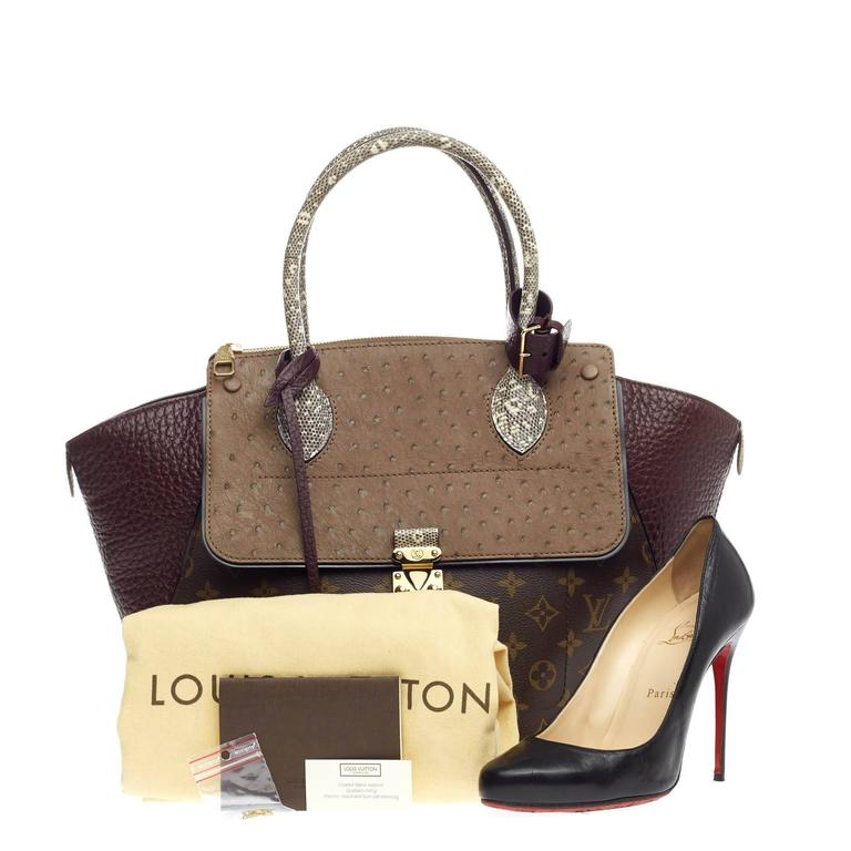 6b7f06f888f1 This authentic Louis Vuitton Majestueux Tote Monogram Canvas and Exotics MM  presented in the brand s Fall