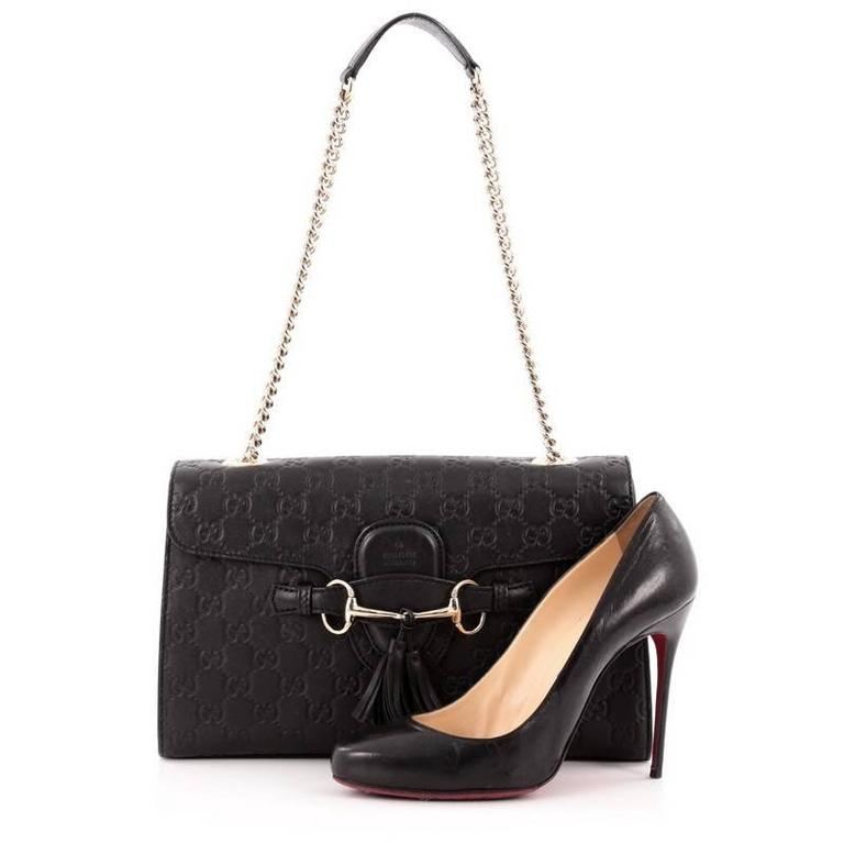b1f63a1085c This authentic Gucci Emily Chain Strap Flap Bag Guccissima Leather Medium  is a stylish accessory perfect