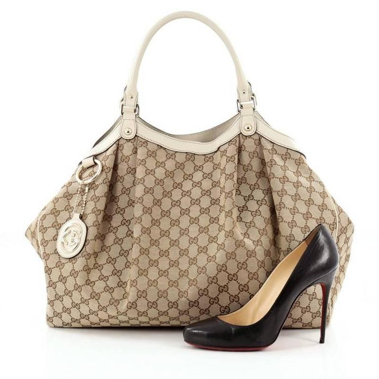 d0c46ade504e This authentic Gucci Sukey Tote GG Canvas Large is perfect for any casual  or sophisticated outfit