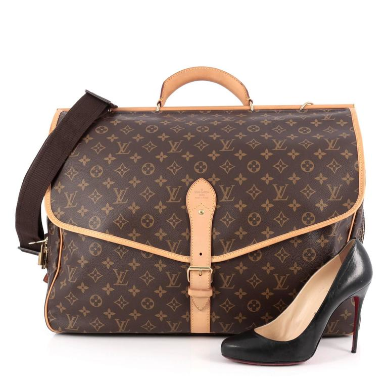 c092655751a This authentic Louis Vuitton Sac Chasse Hunting Bag Monogram Canvas is a  must-have for