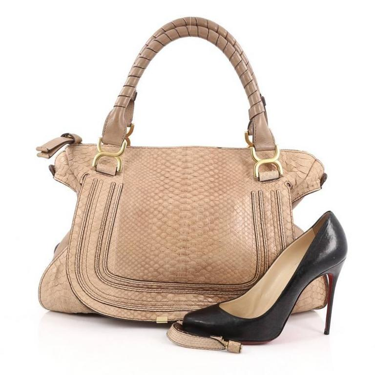 80e4d070b07 This authentic Chloe Marcie Shoulder Bag Python Large showcases the brand's  popular horseshoe design in a