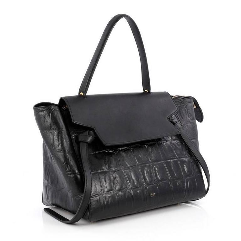 77de5acc95e This authentic Celine Belt Bag Crocodile Embossed Leather Medium is sure to  make a statement.