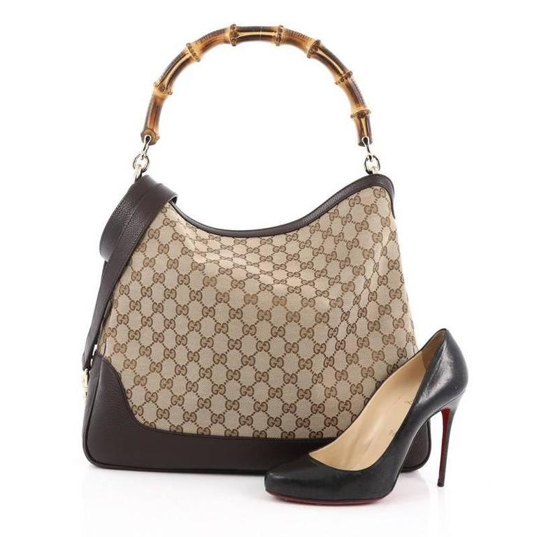 a16475179d03eb This authentic Gucci Diana Bamboo Shoulder Bag GG Canvas Medium is classic  and sophisticated in design