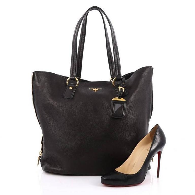 386ce4158683 This authentic Prada Side Zip Shopper Tote Vitello Daino Large exudes a  stylish and industrial design
