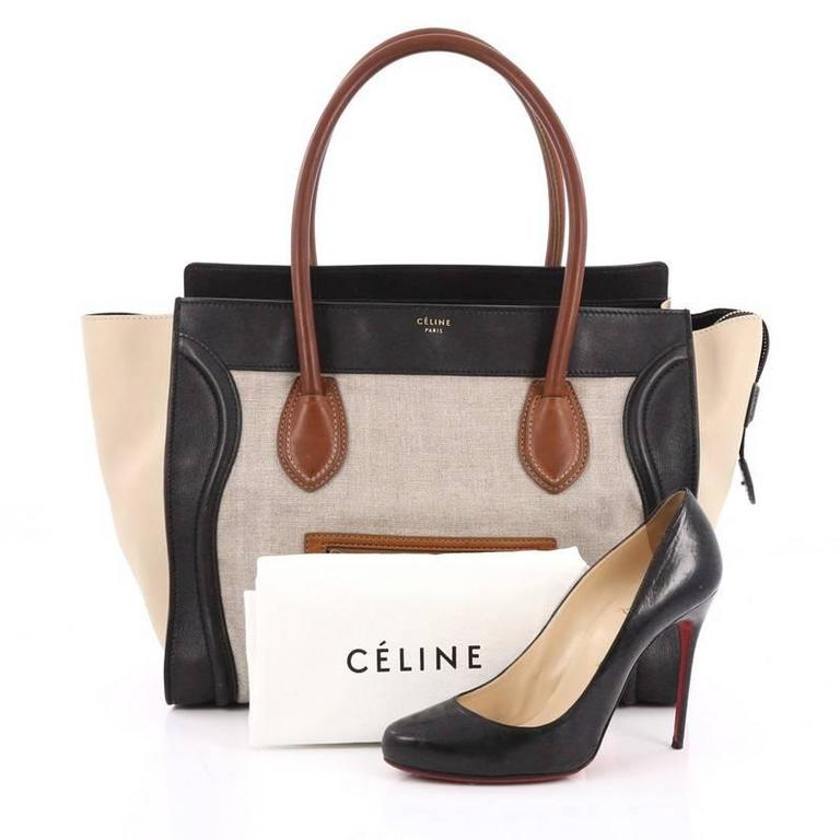 This authentic Celine Tricolor Shoulder Luggage Bag Canvas and Leather is one of the most sought-after bags beloved by fashionistas. Crafted from tricolor beige canvas, black and brown leather with beige leather side wings, this minimalist tote