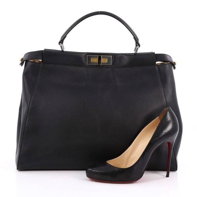b7b20d38d8 This authentic Fendi Peekaboo Handbag Leather with Calf Hair Interior Large  is one of Fendi s best