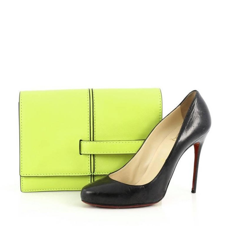 This authentic Valentino My Own Code Clutch Leather is a versatile piece that complements both casual and dressy looks. Constructed from neon yellow leather, this clutch features black hand painted edges, single front handle strap that comfortably