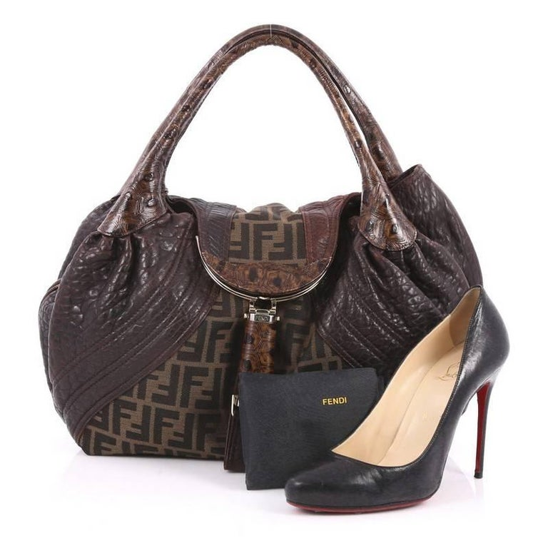 270b0b2dc02c This authentic Fendi Tortoise Spy Bag Zucca Canvas and Leather showcases  one of the brand s most