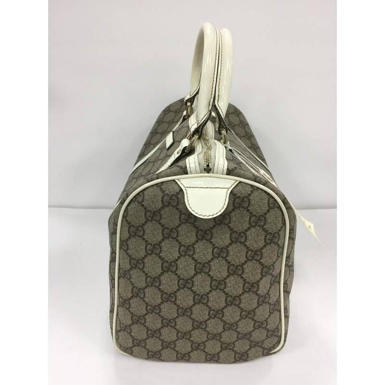 656f855b146 This authentic Gucci Joy Boston Bag GG Coated Canvas Medium is a simple and  stylish companion