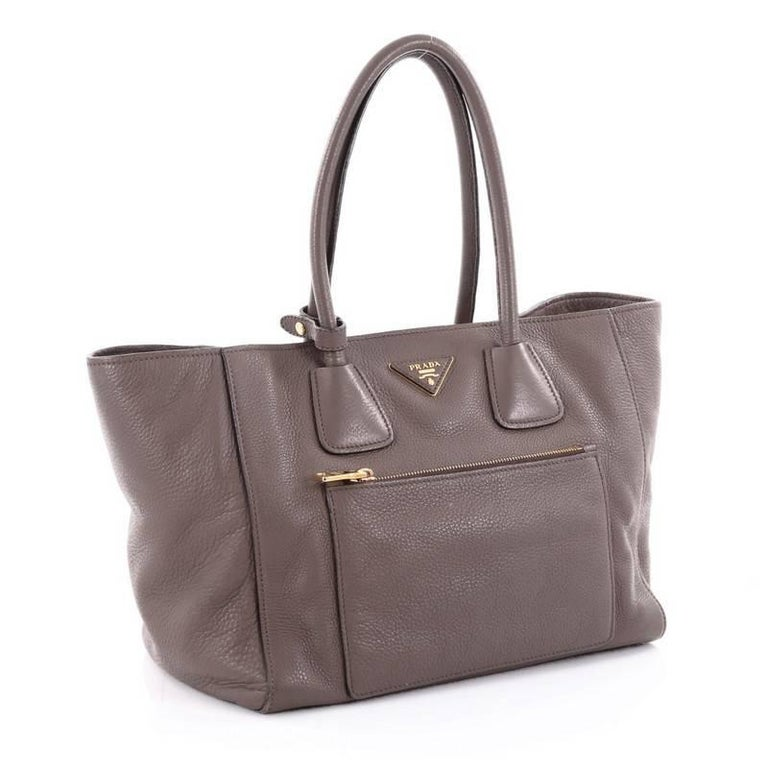 d25dadd0ec81 ... exudes a stylish and industrial design. Gray Prada Front Pocket Wing Convertible  Tote Vitello Daino For Sale
