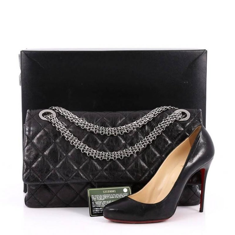 e7693e49c146b2 This authentic Chanel Reissue 2.55 Handbag Quilted Aged Calfskin 228 is an  elegant and timeless piece