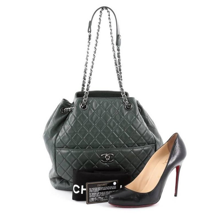 This authentic Chanel Drawstring CC Lock Bucket Bag Quilted Lambskin Medium  exudes a nature of casual 82b96e0037