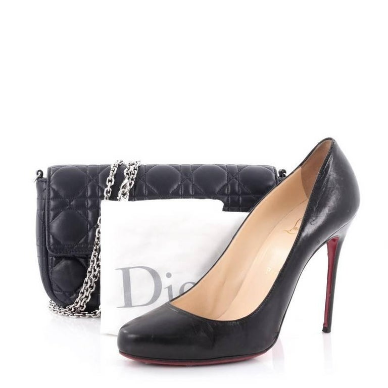 This authentic Christian Dior Miss Dior Promenade Handbag Cannage Quilt Lambskin showcases an elegant and modern design that is perfect for nights out. Crafted from navy blue cannage quilt lambskin leather, this bag features a flap with push-lock