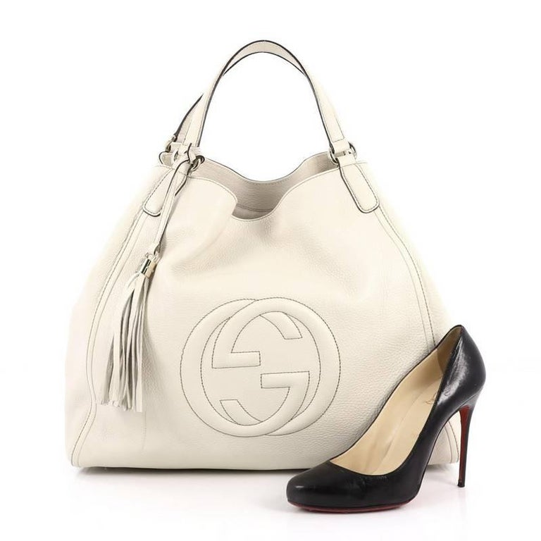 cebe9d5ae6 This authentic Gucci Soho Shoulder Bag Leather Large is simple yet  luxurious in design. Crafted