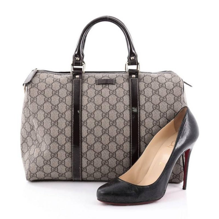 92256c29f797 This authentic Gucci Joy Boston Bag GG Coated Canvas Medium is a simple and stylish  companion