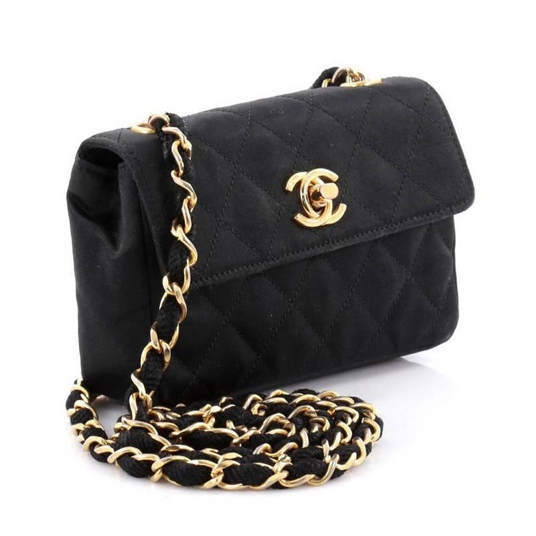 e7fab726756d This authentic Chanel Vintage CC Chain Flap Bag Quilted Satin Extra Mini is  surely an added