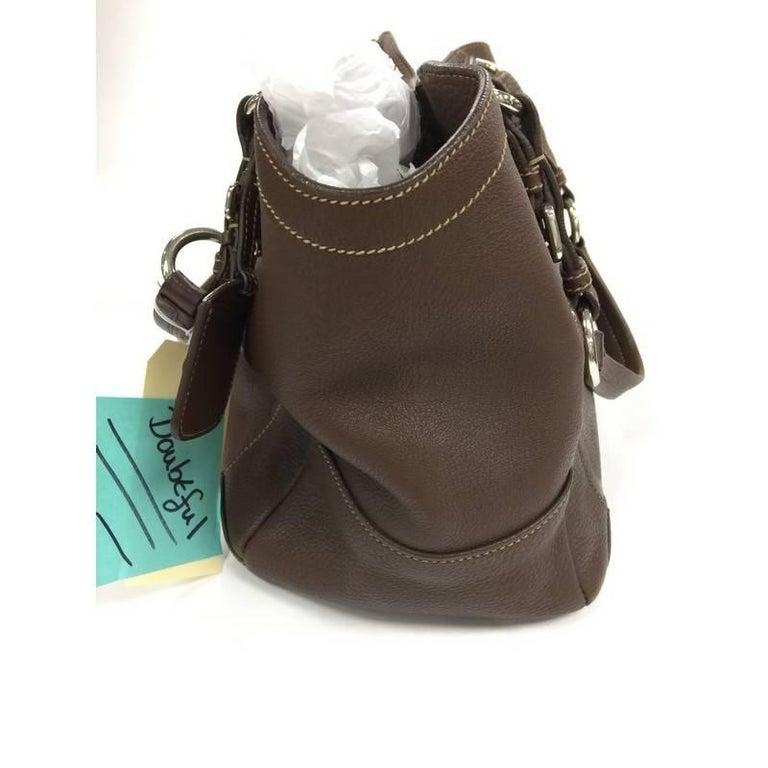 411ce09737bca4 This authentic Prada Buckle Strap Shoulder Bag Vitello Daino Medium is a  classic and practical bag