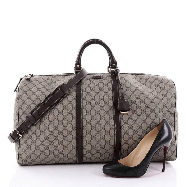6dfeba664539 This authentic Gucci Carry On Convertible Duffle Bag GG Coated Canvas  Medium is a classic travel